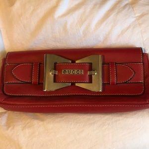 Red Gucci clutch purse